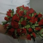 The bride carried red roses
