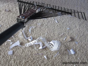 Cleaning the floor with a rake