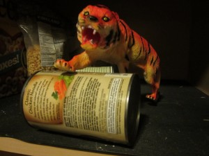 Bob, the tiger rolls out the canned food.