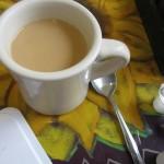 Drinking coffee alone.
