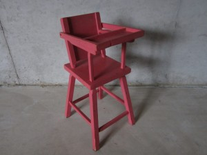 The pink high chair my father made for me.