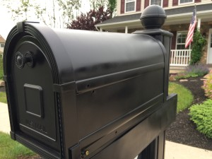 The repaired mailbox with a new coat of paint.